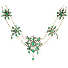 Victorian Pearl, Diamond & Emerald Necklace. Backed in 18 karat gold, topped in silver & consisting of 9 graduated plaques, each constructed in a star motif & containing bezel-set pear-shaped, square & rectangular step-cut emeralds, cabochon emeralds, crimped collet & bezel-set old mine-cut diamonds. The plaques are attached by gold link chains strung with near-round & oval pearls & is completed by a clasp bezel-set with 1 large emerald-cut emerald & 14 old mine-cut diamonds. Circa 1860.
