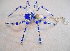 Taylor  blue and silver glass beaded spider goth sun by llanywynns