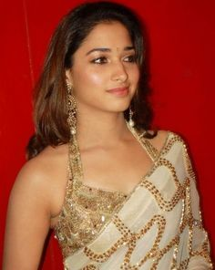 South Indian actress Tamanna in a sleeveless noodle strapped blouse with saree