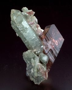Ferro-Axinite on Quartz with Chlorite inclusions - Bourg d'Oisans, Isere, Rhone-Alpes, France Size: 5.0 x 4.5 x 3.0 cm ☞ Natural History Museum of Los Angeles County