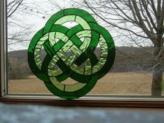 Celtic Irish Knot Stained Glass Window Panel Suncatcher. $84.99, via Etsy.