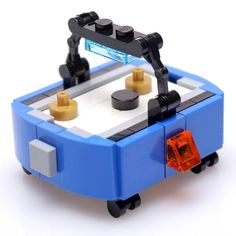 An air hockey table is the perfect addition to your LEGO arcade MOCs and your LEGO City displays. Perfect size for your LEGO minifigures. Includes instructions and 52 new authentic LEGO bricks for building the air hockey table. Legos, Minifigura Lego, Lego Craft, Lego Moc, Lego Batman, Lego City, Lego Design, Lego Friends, Pokemon Lego