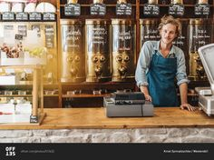 Portrait of confident coffee roaster in his shop stock photo - OFFSET