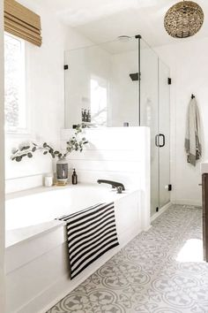 Reveal: Boho Farmhouse Master Bathroom Remodel with Decor Sources. Bathroom with white subway tiles, white& The post Reveal: Boho Farmhouse Master Bathroom Remodel with Decor Sources appeared first on England Gardens. Bad Inspiration, Bathroom Inspiration, Cool Bathroom Ideas, Bath Ideas, Shower Ideas, Interior Design Minimalist, Design Living Room, White Subway Tiles, Modern Farmhouse Bathroom