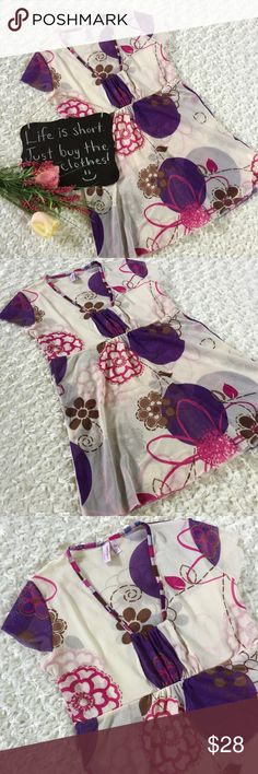 """Sweet Pea by Stacy Frati floral top Adorable cream, purple and pink cap sleeve top. Sweet Pea by Stacy Frati. Size M. 16"""" arm pit to arm pit. 27"""" length. Sweet Pea Tops"""