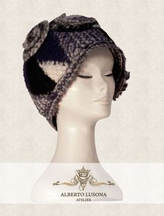 Alberto Lusona Fall/Winter Collection 2013 - WOOL HAT WITH SPIRAL DECORATIONS.  Warm and unique, this hat gives jaunty style while remaining elegant.  Colors, stitching and diagonals remain part of the work as a background for the playful curves and spirals that become the real protagonists of this original article. $120 #albertolusona #boiledwool #eleganthat #retrostyle #clochehat
