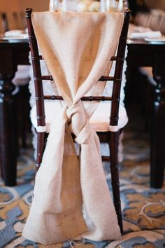 OK folks ~ We officially LOVE this chair sash!!!  Here's what it looks like in the full room view: http://www.stylemepretty.com/gallery/picture/516519 ~  Photography by erinheartscourt.com, Wedding Coordination by joydevivre.net
