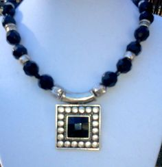 Single strand necklace featuring a large silvertone by d3tennis, $35.00