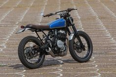 Marco di Marcello works as a physiotherapist—but he has built a custom Honda Dominator NX650 worthy of a pro garage.