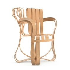Frank Gehry Cross Check Arm Chair Functional art in ribbon strips of hard white maple veneer, each Cross Check chair is embossed with Frank Gehry's signature. Designer: Frank Gehry, 1990 Manufacturer: