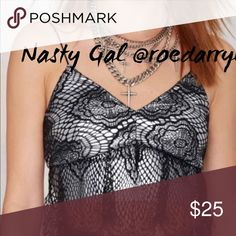 JUST IN Nasty Gal Metalic Lace Cami Sexy Lace Crop Top.  Never used in excellent condition.  Short Zipper back.  True to size Nasty Gal Tops Crop Tops