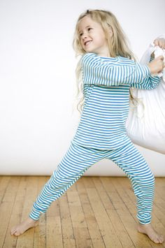 Organic cotton pajamas in long johns style in our popular blue carribe stripe. Sizes 9/12 mos to youth 12.