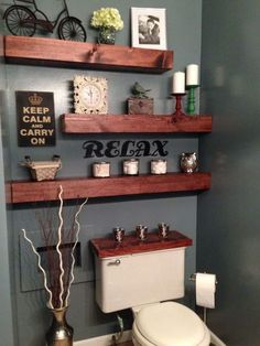Beautiful DIY bathroom shelves idea over the toilet. Love the gray wall paint to…