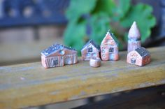 Miniature village with silver wash and pewter roofs. Alyssa Gillooley