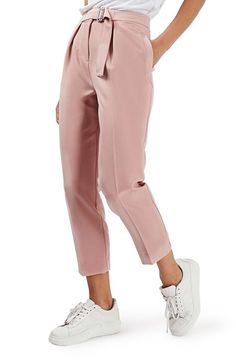 Free shipping and returns on Topshop Slider Utility Peg Trousers (Regular & Petite) at Nordstrom.com. Stay at ease in cropped, creased trousers cut from flexible crepe fabric and cinched by a relaxed pleated waistline with an attached, military-inspired sliding belt.