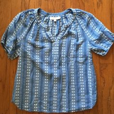 LOFT Embroidered Top - NWOT This LOFT top is beautiful and embroidered. It's chambray-like material is beautiful and breezy for summertime. NWOT LOFT Tops Blouses