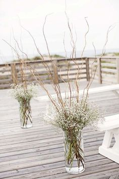Wedding Flowers cheap wedding decorations flowers gypsophila in tall vases with wooden branches kristi midgette photography - Elegant doesn't mean expensive. You can make unique and cheap wedding decorations. See our gallery and make sure it is easy! Branch Centerpieces, Willow Branch Centerpiece, Centerpiece Ideas, Curly Willow Centerpieces, Winter Table Centerpieces, Simple Centerpieces, Cheap Wedding Decorations, Cheap Flowers For Wedding, Inexpensive Wedding Centerpieces