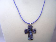 Love this periwinkle blue leather and enameled copper cross necklace.  Lobster claw clasp.  $30