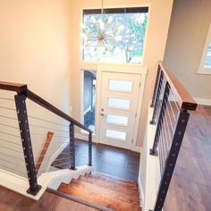 post of the entryway at our Puyallup split level flip. Replacing the walls with cable railing Split Foyer Entry, Split Level Entryway, Split Level Exterior, Split Level Home, Split Level Kitchen, Split Entry Remodel, Split Level Remodel, Bi Level Homes, Staircase Design
