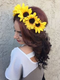 Stunning headband with medium sized sunflowers. Flowers are attached to tan suede leather cord and are backed with felt for comfort and security. Headband can be fastened in back for a perfect fit on