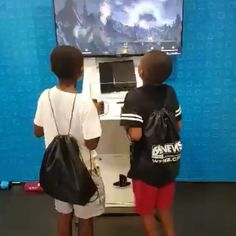 The kids found a Play Station  4  station. They were excited.