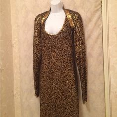 """Donna Karan midi black dress w/sequin gold size M Donna Karan midi black dress w/sequin gold size M. With lining 100% cashmere. Long sleeve balero over the dress. Dress sides seam 39"""" long. New without tag. Never worn. The dress has a cashmere 70%/silk 30% slip ; in solid black and not attached to the dress. No trade. Price firm; unless bundle. Donna Karan Dresses Midi"""
