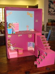 dollhouse from boxes and cardboard love the steps gonna have to make some for the girls Barbie house :)
