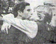 Charles and Diana Kissing! Really rare picture!  Yeah, but she's doing all the holding, and he's looking at the photographer.....: