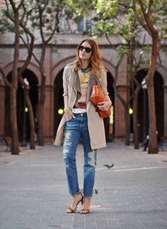 graphic tee, trench coat, ripped boyfriends, orange clutch, shades and necklace..love it all!