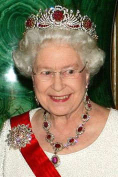 QEII in the Crown Ruby Necklace and Ruby Drop Earrings. Queen Victoria commissioned a magnificent necklace of opals surrounded by diamonds with a matching pendant and drop earrings which she later left to the Crown. No fan of opals, Queen Alexandra had them switched for stunning large rubies on the necklace, earrings, and also on the Oriental Circlet Tiara