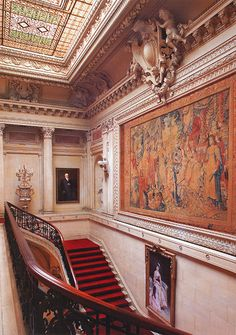 The Breakers | Cornelius Vanderbilt II, Newport, RI. Pictured: The Staircase, in the Italian Renaissance style by Richard Morris Hunt decorated with a huge Flemish tapestry designed by Karl van Mander in 1619. Below the tapestry is a portrait of Mrs. Cornelius Vanderbilt in the year of her marriage (1867), painted by the Spanish artist Raimundo de Madrazo y Garreta (1852-1917).