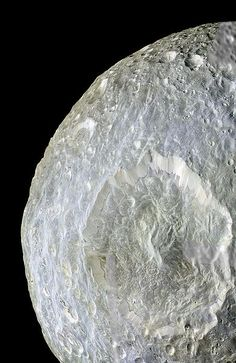 Subtle colour differences on Saturn's moon Mimas are apparent in this false-colour view of Herschel Crater captured by NASA's Cassini spacecraft during its closest-ever flyby of that moon.