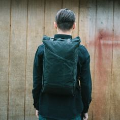 Our Venture pack in a black waxed canvas ripstop, black leather, and black hardware.