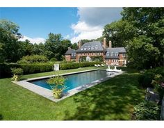 Lavish lap pool in the backyard of this magnificent Georgian Colonial Weston, MA home, which is surrounded by gardens, orchard and meadows designed by a world renown landscape architect. Lounge in the grass or in the newly built pool house!