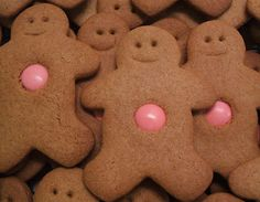 gingerbread men cookies with pink gumball bellies -- gumballs available at candymachines.com use promo code PIN for a 10% discount