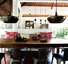 I like the open airy feel of this and the low lighting over the table would be good for evening. Bali beach house interior