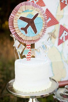 vintage airplane party: paper + brown coffee filter medallions with map and glitter plane topper; map bunting on striped straws for cake