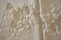 Details of relief of porcelain tex-tiles #tiles #transparant #white #translucent #porcelain #15x15 #bathroom #textiles #wall #decoration #led #imprint #relief #barbaravos #wallcovering #kitchen #shower #home #interior #design #glaze #backsplash #flower #pattern #coral #fabric