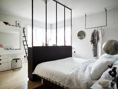 Window room divider in a shared parent / child bedroom. Small space inspiration - from the home of a Swedish stylist. Joanna Bagge /  Jonas Berg. Stadshem.