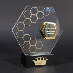 This trophy employs the use of glass and metal, in a very out-there hexagonal…