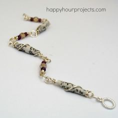 Wire Wrapped Paper Bead Bracelet (I made fabric beads from a vacation item that would look great like this! Paper Bead Jewelry, Fabric Jewelry, Paper Beads, Wire Jewelry, Jewelry Crafts, Beaded Jewelry, Handmade Jewelry, Beaded Bracelets, Fabric Beads