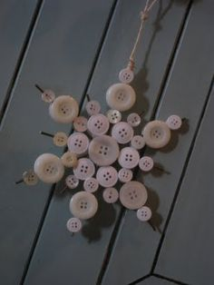 Christmas Snowflake Ornament made with vintage buttons glued to thin wire strips to form snowflake.