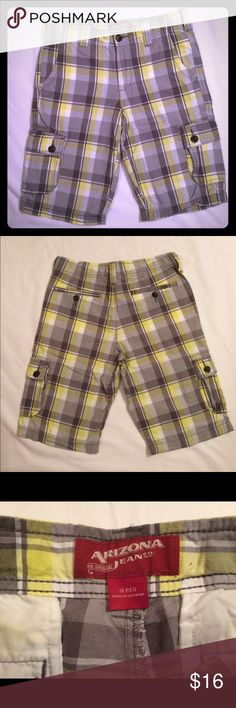 NWOT boys Arizona yellow plaid shorts NWOT boys Arizona yellow plaid shorts size 16. These have yellow, dark grey and white in them. They actually fit like a 14. I bought these for my son who was a 16 at the time and they were a size too small...we had to get him an 18. So please keep this in mind. They are a bit wrinkled from being washed and folded in a bag, but other than that they are in excellent condition! Never worn! Arizona Jean Company Bottoms Shorts