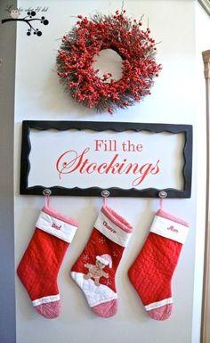 No mantel Christmas decorating idea! Use any empty frame and hooks... More DIY mantel decorating ideas!