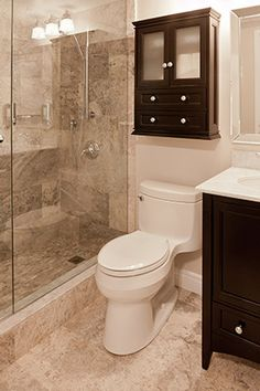 Gorgeous modern-traditional bathroom remodel with frameless glass shower enclosure & door and dark-brown bathroom vanity with marble top & oval sink on Replace Tub With Shower, Small Bathroom With Shower, Beige Bathroom, Bathroom Interior, Modern Bathroom, Master Bathroom, Shower Bathroom, Small Bathrooms, Frameless Shower