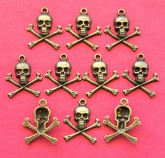 10 #SKULL and #CROSSBONE #Charms antique bronze tone by beadingshaz, £1.35