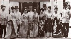 Filipino women in the traditional baro't saya with butterfly sleeves and overskirt, Filipino men in barong Tagalog