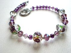 Lavender bead bracelet - lilac glass flower beads with gold, crystals & seed bead bracelet, 7 3/4 inch bracelet. wire strung toggle clasp by IvoryCatCreations on Etsy https://www.etsy.com/listing/200017182/lavender-bead-bracelet-lilac-glass