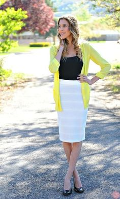 A yellow cardigan and a white pencil skirt are appropriate for both smart casual events and day-to-day wear. Black leather pumps are a smart choice to complete the look.