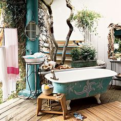 Forget a quick rinse in an outdoor shower―opt for a long soak under the stars. Turn a private deck into an outdoor bath with                                            a freestanding tub and pedestal sink for the ultimate alfresco experience. A flea-market stool can keep accessories nearby.